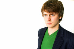 Scowling young man Stock Images
