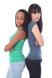 Scowls medi seri delle ragazze africane e giapponesi Fotografia Stock