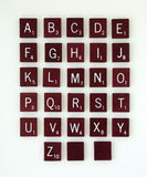 Scrabble Alphabet. Dark brown, scrabble, alphabet tiles with numbers Royalty Free Stock Photo