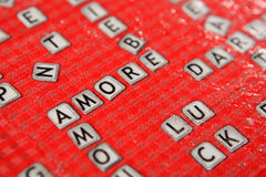 Scrabble amore. Scrabble board game with the word amore written Royalty Free Stock Images