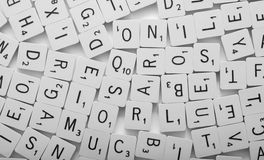 Scrabble background. Background of many scrabble pieces with letters Stock Image