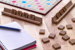 Scrabble board game with the scrabble tile spell `Game Day`