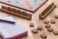Scrabble board game with the scrabble tile spell `Game Over`