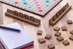 Scrabble board game with the scrabble tile spell `Game Time`