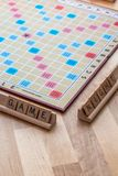 Scrabble board game with the scrabble tile spell `Game Night`. On a table royalty free stock photo