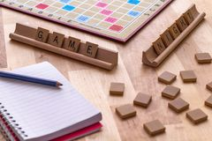 Scrabble board game with the scrabble tile spell `Game Night`. On a table royalty free stock photos