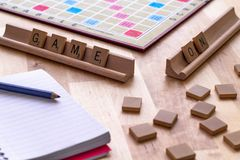 Scrabble board game with the scrabble tile spell `Game On`