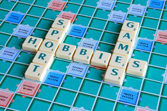 Scrabble board games hobbies. Photo of scrabble board game with words relating to games and sport etc Royalty Free Stock Photo
