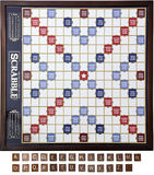 Scrabble Board & Tiles. Top view of a wooden scrabble board Stock Photo