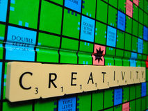 Scrabble creativity. A scrabble board with the word inspiration. Great for news articles on creativity and encouragement Stock Images