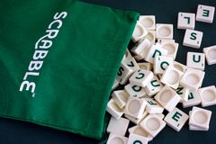 Scrabble drawstring letter bag with letter tiles. Tambov, Russian Federation - May 02, 2018 Scrabble drawstring letter bag with letter tiles. Studio shot Stock Image