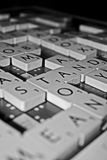 Scrabble game in black and white. Family board game of scrabble played at night Stock Images