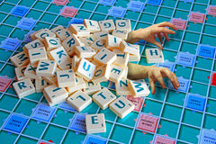 Scrabble hands Stock Image
