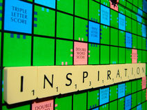 Scrabble inspiration. A scrabble board with the word inspiration. Great for news articles on creativity and encouragement Royalty Free Stock Images