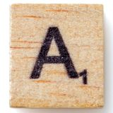 Scrabble Letter A alphabet uppercase. On white background royalty free stock photography
