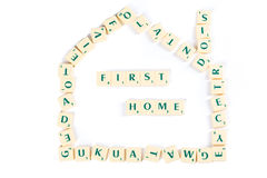Scrabble Letter Tiles for First Home Concept Stock Image