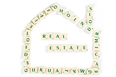 Scrabble Letter Tiles For Real Estate Concept Royalty Free Stock Image