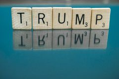 Scrabble Letter Tiles spelling President Trump. Can be used to illustrate the divide in our nation, social issues, for against republican or democrat policies Royalty Free Stock Photos