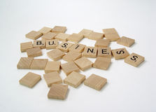 Scrabble Letters. Photo of Scrabble Pieces Spelling Business - Part of Series stock photos