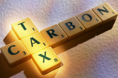 Scrabble letters carbon tax Royalty Free Stock Images