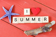 Scrabble letters with I love Summer. Text and starfish stock image