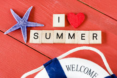 Scrabble letters with I love Summer. Text and starfish royalty free stock images