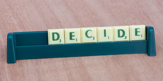 Scrabble letters spelling decide Stock Photography