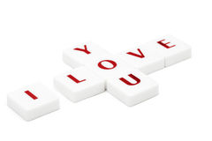 Scrabble letters spelling I love you isolated on white Royalty Free Stock Image