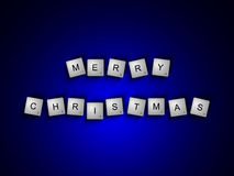 Scrabble letters spelling merry christmas greetings over dark Royalty Free Stock Image