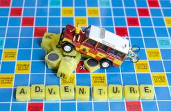 Scrabble letters spelling the word adventure Royalty Free Stock Images