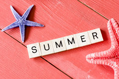 Scrabble letters with Summer. Text and starfish stock images