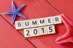 Scrabble letters with Summer 2015. Text and starfishes stock photos