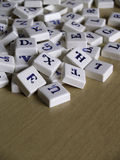 Scrabble pieces. Over wood background Royalty Free Stock Images