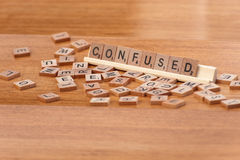 Scrabble pieces spelling confused Royalty Free Stock Images
