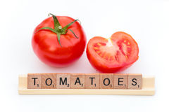 Scrabble pieces spelling TOMATOES Stock Photos