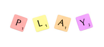 Scrabble Play Sign. Play - a colored word from scrabble stock photography