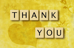 Scrabble Thank You. Wooden scrabble tiles spelling out Thank You against yellow background. Illustration Royalty Free Stock Photography