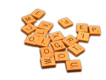 Scrabble Tiles. Pile of random scrabble letters stock photos