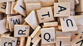 Scrabble tiles with letters