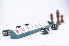 Scrabble Tiles placed on a green plastic tile holder Stock Photos