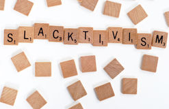 Scrabble tiles spell out 'Slacktivism' Royalty Free Stock Photography