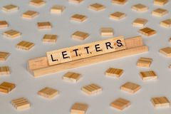 Scrabble tiles spelling Letters royalty free stock image