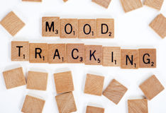 Scrabble tiles spelling out 'Mood Tracking' Stock Photos