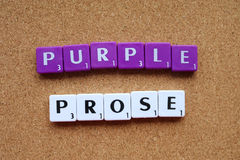 Scrabble tiles spelling out purple prose. Letter tiles spelling out purple prose to express the concept of flowery language stock photo