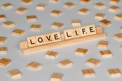 Scrabble tiles spelling Love Life. Scrabble Word Game wood tiles spelling Love Life on a white background royalty free stock photography