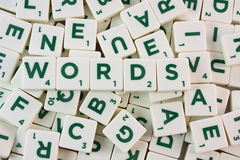 Scrabble WORDS. Bunch of scrabble pieces with word WORDS in the center Stock Photo