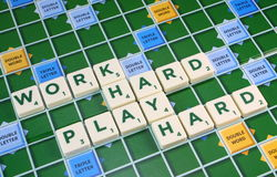 Scrabble WORK HARD PLAY HARD Royalty Free Stock Photography