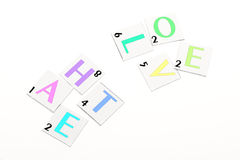 Scrabbled hate and love Stock Photo