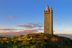Scrabo Tower. On nice sunny day blue sky and green grass Royalty Free Stock Image