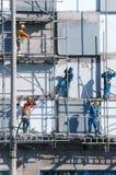Scraffold asiático del trabajador de construcción, solar Fotografía de archivo libre de regalías